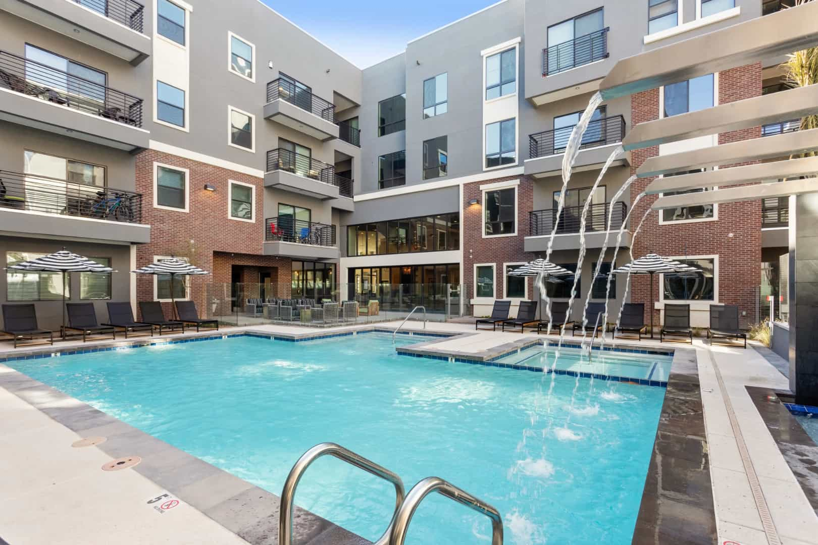 Pool with Waterfalls | Alta Central Phoenix AZ Apartments